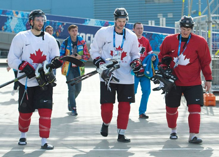Patrice Bergeron, Jamie Benn, and Sidney Crosby walk back from practice on Feb. 22, 2014 #Sochi2014 (Nathan Denette / THE CANADIAN PRESS)