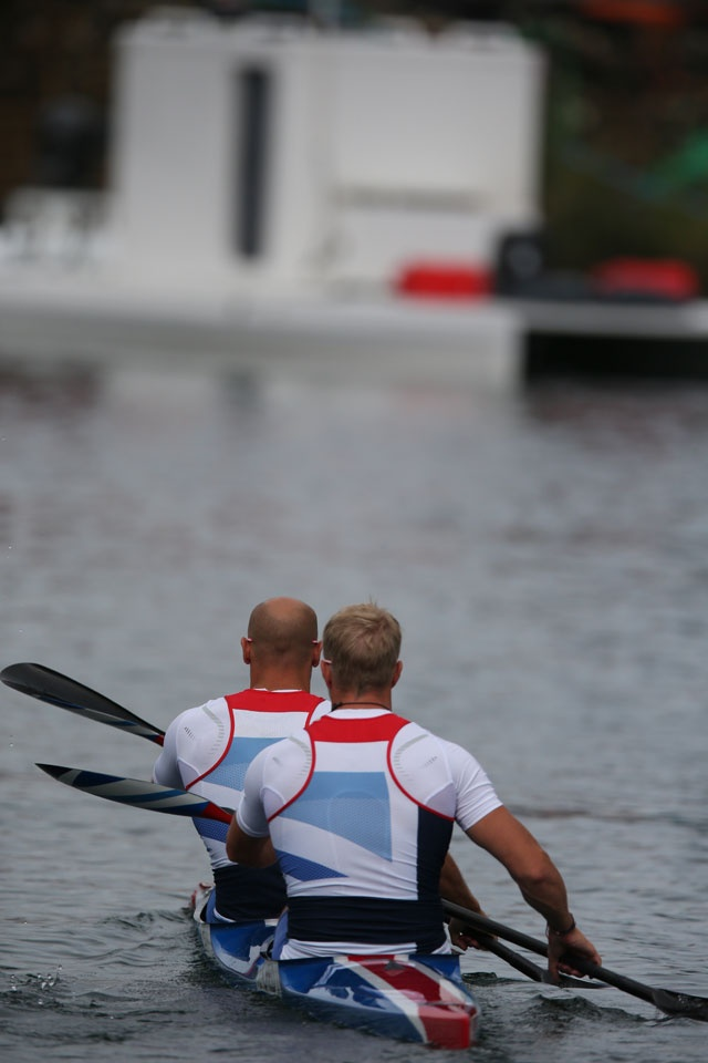London 2012 - Liam Heath (bow) and Jon Schofield of Great Britain spend some time on the water practicing for their next-day final in men's kayak K2 200m sprint.  IOC/Jason Evans