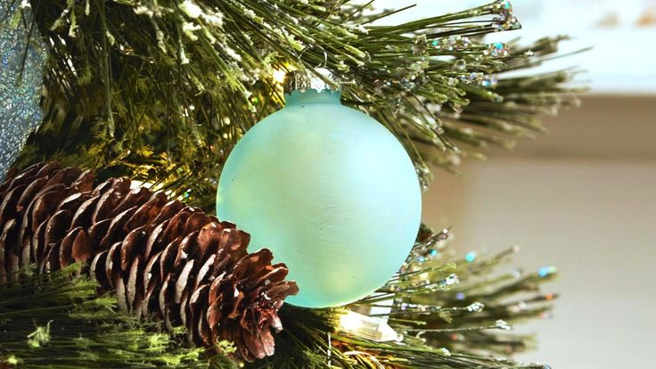We used specialty sea glass paint in order to give glass ornaments a frosted aqua-colored effect.
