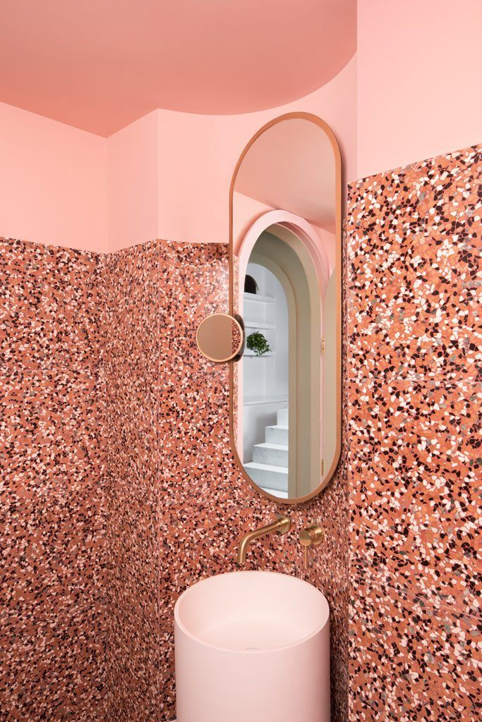 The Budapest Café in Chengdu, China, by Biasol studio is inspired by film director Wes Anderson's style - Huskdesignblog | Wes Anderson decoration | Biasol design studio | green interior | green walls | 2018 interior design trends | pink bathroom | modern café | contemporary café | sculptural interior | minimalist architecture | pink seating | marble counter | arches | minimal lighting fixtures | China coffee shop | millennials place | instagram interior design | 2018 colors | pink terrazzo