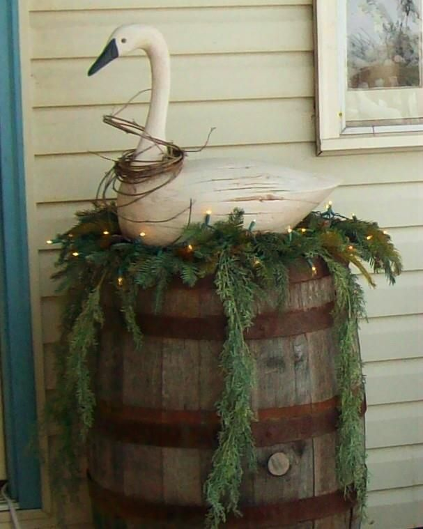 Oh oh oh!!! LOVE this chippy wooden swan! Looks so regal and festive as he guards the Christmas greenery in the wooden barrel!