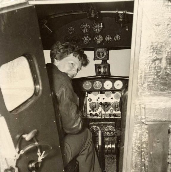 Amelia Earhart in the Electra cockpit, c.1936. Biography  Facts About the Disappearance of Amelia Earhart, July 2, 1937, Pacific Ocean, en route to Howland Island.