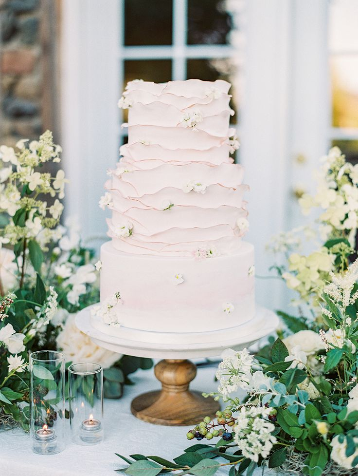 pale blush ruffle cake with edible flowers | Photography: Sally Pinera