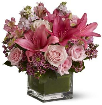 Pastel Cube   Lilies, roses and waxflower in a cube