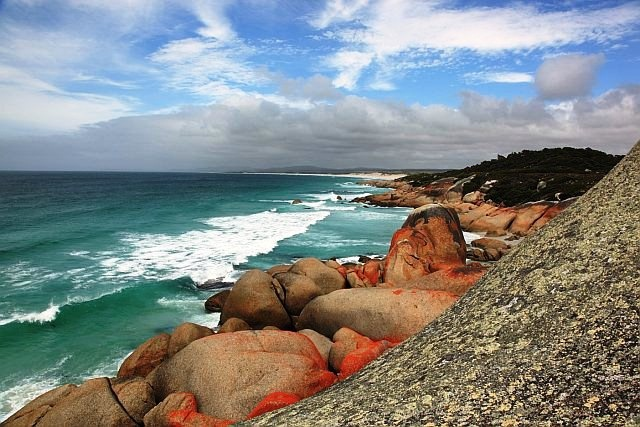 Just another day in Tassie walking along the Bay of Fires. Photo courtesy of Jo Unger, wife of Dr. Isadore Unger.