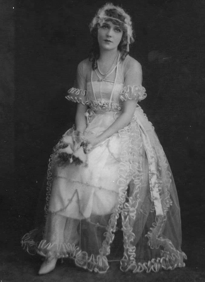 Mary Pickford in her wedding dress from her second marriage to Douglas Fairbanks, 1920. Photo by Nelson Evans