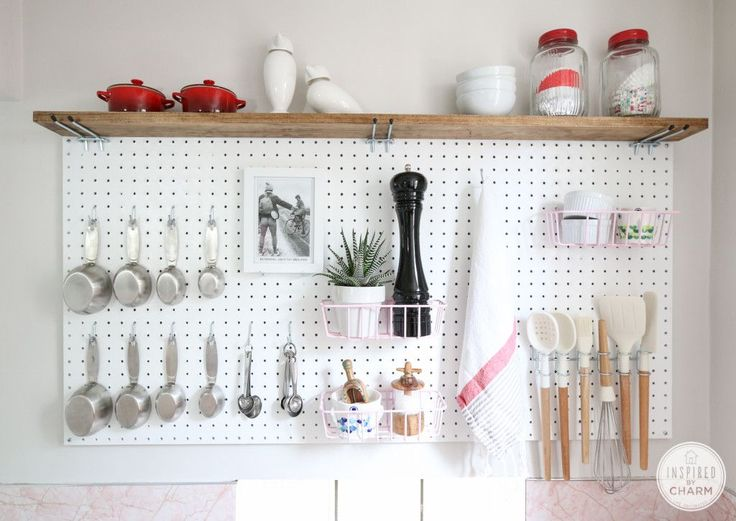 Here's a new variation on open kitchen shelves!  Inspired by Charm created a pegboard kitchen storage solution that you'll love.