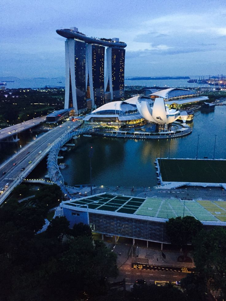The Marina Bay Sands resort is designed by Moshe Safdie, who says it was initially inspired by card decks. In addition to the casino, other key components of the plan are three hotel towers with 2,500 rooms and suites, a 19,000m2 (200,000sqft) ArtScience Museum and a convention centre with 110,000m2 (1,200,000sqft) of space, capable of accommodating up to 45,000 people. The resort's architecture and major design changes along the way were also approved by its feng shui consultants