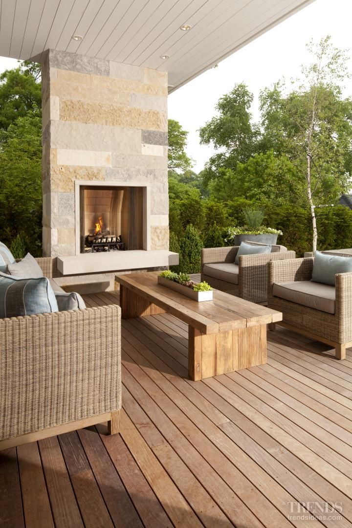 Contemporary covered outdoor space with fireplace. Great conversation area.