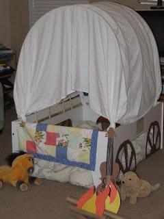 """This is do-able: Cardboard box and a sheet """"wagon"""""""
