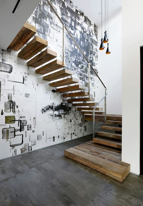 Industrial style staircase and cool wall mural