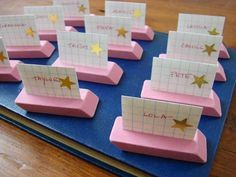 Name plates plus quick access to eraser. Use Exacto knife to cut a slit in middle lengthwise. Write name on note card and place in eraser.