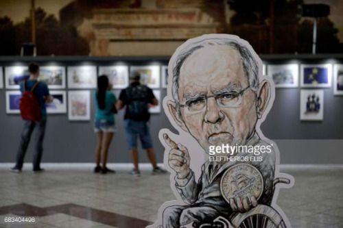 05-15 A cartoon of Wolfgang Schäuble holding a Greek drachma...… #sanktwolfgangbundeslandoberosterreich