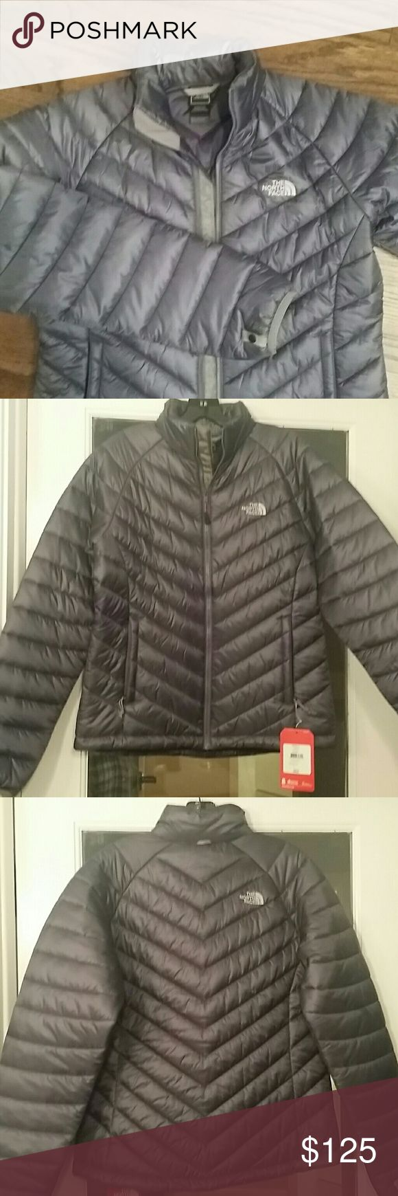 North Face Venia Jacket Lightweight ladies jacket.  Greystone blue.  Looks a bit grayish purplish bluish at times.  Very pretty color but I thought I was getting a more navy color when I purchased it. North Face Jackets & Coats Puffers