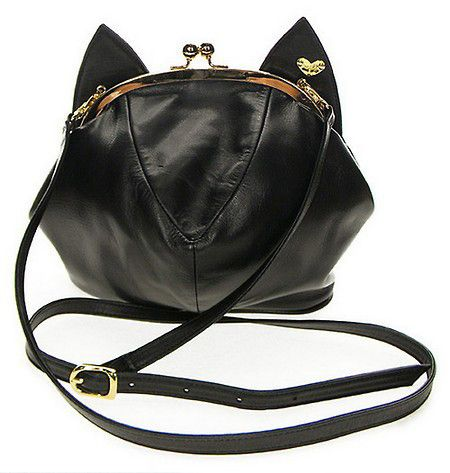 Description A compact black cat purse is an essential wardrobe accessory - but ordinary won't cut it at Meowingtons. This unique design is just puurrrfect for t