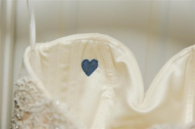 """""""Something Blue""""- heart sewn into her wedding dress made from her dad's shirt"""