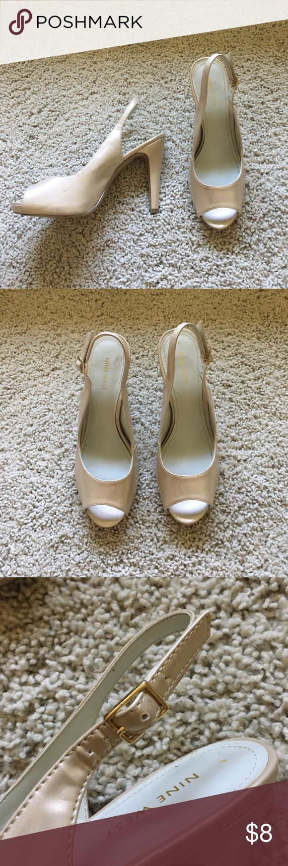Nine West Champagne Slingback Heels Nine West champagne colored slingback heels. About 4 inches. They do have a drew scuffs and marks, but nothing is extremely noticeable, except for one of them. The straps are a little flimsy, but only when you're not wearing them. There are also some marks where your feet go, but no foot stains. Nine West Shoes Heels
