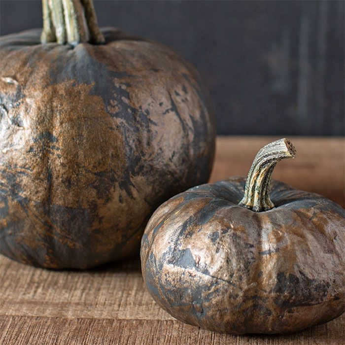 Set a stylish scene this fall with gilded pumpkins. Apply a charcoal gray spray paint and then dab with gold and copper metallic paints for a two-tone effect.