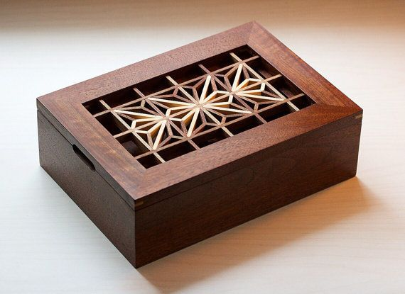 This hand made jewelry/valet box features a detailed walnut and eastern white pine kumiko latticework lid, which lifts off to reveal a sliding tray, perfect for small jewelry or a watch. It has been rubbed with a high grade furniture oil and polished with three coats of wax, leaving a silky smooth finish. The kumiko box is a one-of-a-kind piece as I designed it as I went. I poured my heart into it and hope it becomes a cherished item in someones home. The box measures 10 x 7 x 3 on the…