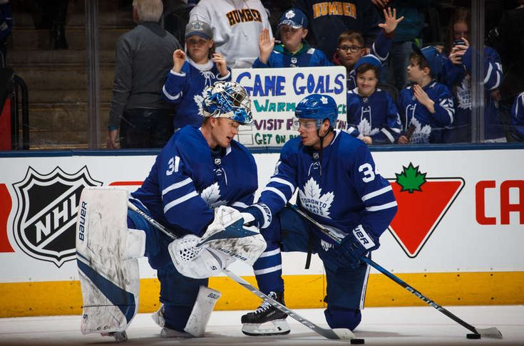 Auston Matthews #34 of the Toronto Maple Leafs talks with teammate Frederik Andersen #31 before facing the Florida Panthers at the Air Canada Centre on February 20, 2018 in Toronto, Ontario, Canada.