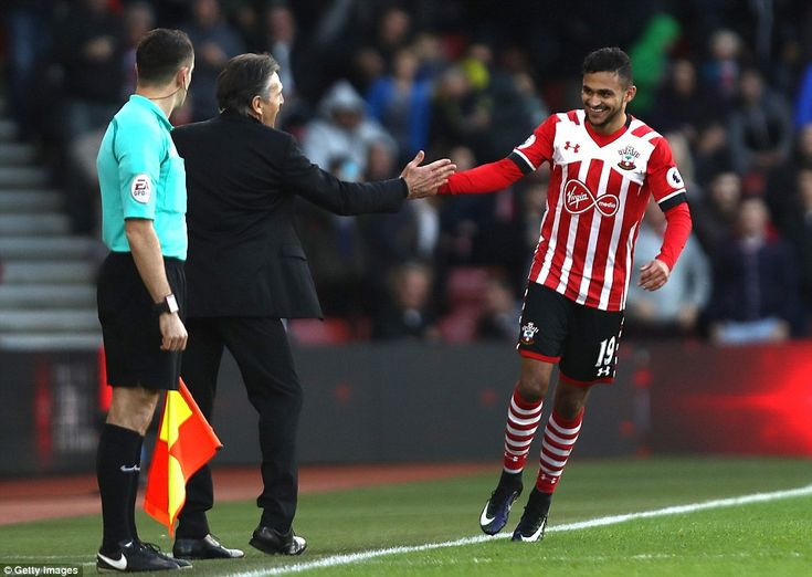 Southampton record signing Sofiane Boufal celebrates scoring the winner with manger Claude Puel