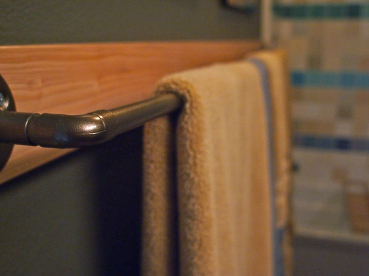 This (sorta) Old Life: DIY custom towel bar. Made out of pipe that would have been thrown away and Rust-Oleum metallic spray paint to make it match the rest of the bathroom! Great Idea!