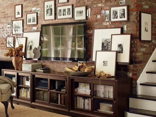 #TV wall #gallery.  LOVE the way this looks!!!  Wish I had an exposed brick wall.