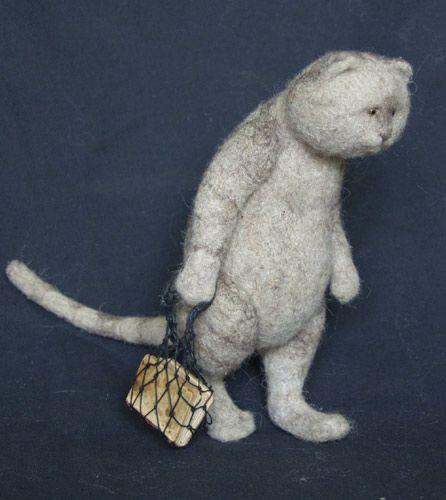'Learned cat'. Handmade needle-felted stuffed animal by Natasha Fadeeva. copyright