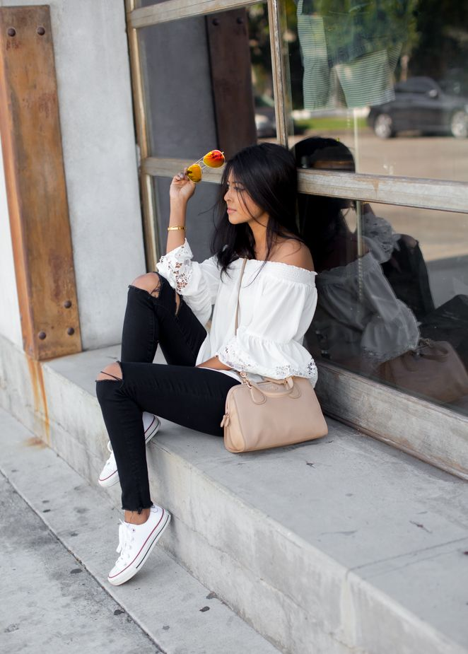 White converse with ripped black skinnies and a white off the shoulder lace shirt is the perfect casual look! Via Sheryl LukeTop: Lord and Taylor, Jeans: J Brand, Shoes: Converse, Bag: Coach, Sunnies: Foster Grant