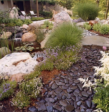 This garden utilizes many different types of stone from for Smooth stones for landscaping