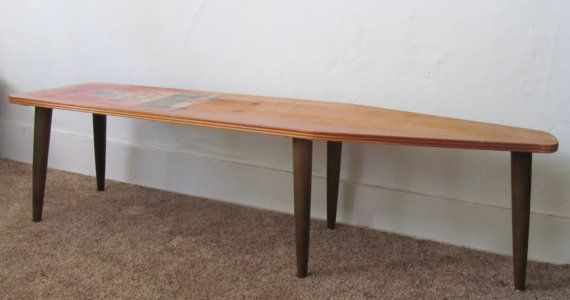 Repurposed Ironing Board Coffee Table / Bench. $225.00, via Etsy.