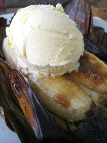 bananas foster -- on the grill in a banana leaf package. this is after it was lit on fire. topped w/ vanilla ice cream.