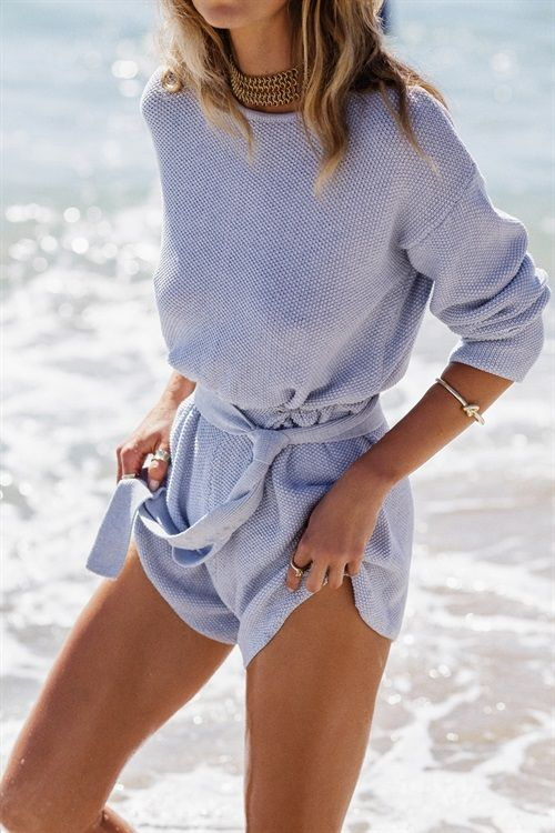 The super cute and cosy Autumn Knit Playsuit is made from a knitted fabric in a baby blue hue. It features full length sleeves, high rounded neckline, elasticated waistband and matching wait tie. Keep it casual and wear with fresh white sneakers! Designed by Sabo Skirt.