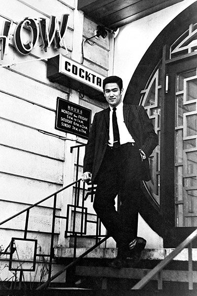 Bruce Lee: Bruce Lee on the steps of Ruby Chow's restaurant in Seattle, where he worked