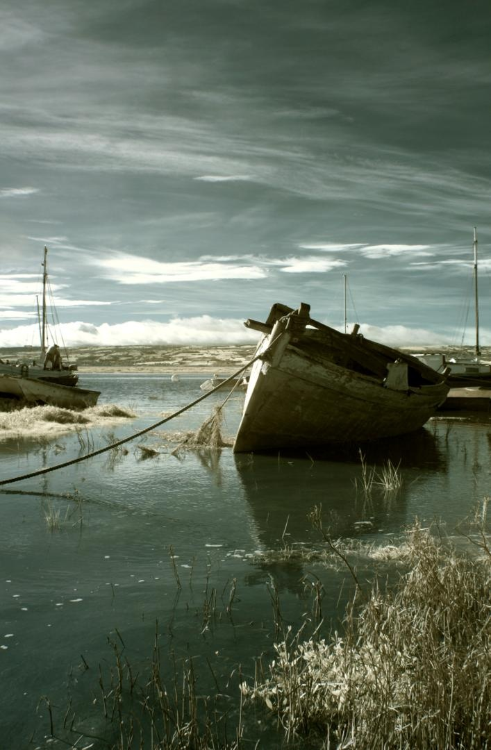Heswall Tidal Marshes and Old Wooden Boats in this enhanced infrared photo