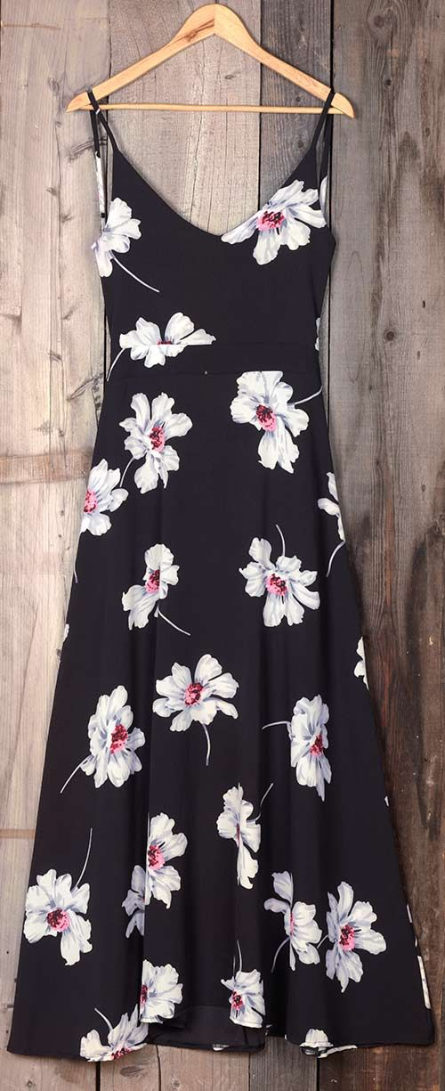 We love the romantic feel of this dress! It's generously printing and open back style like any hot floral dress is! It's just a super sweet spaghetti straps dress!