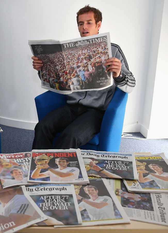 Andy Murray of Great Britain reads through the morning papers at Wimbledon on July 8, 2013 in London, England.