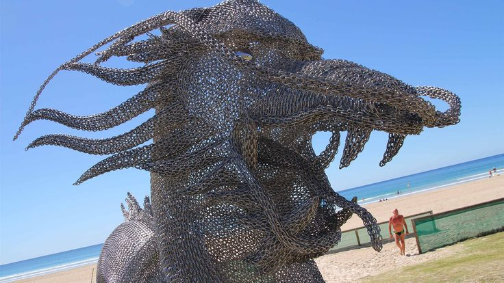 A towering dragon made from steel chains is proving a hit with crowds at the Swell Sculpture Festival on the Gold Coast. (Photo: ABC/Damien Larkins.)