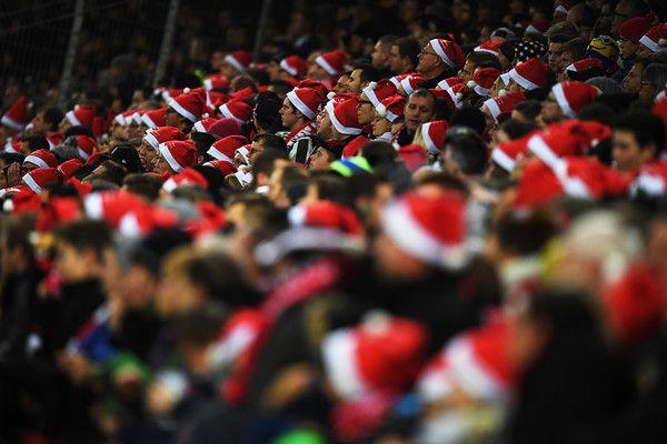 Fans wear Santa hats during the Bundesliga match between SC Freiburg and RB Leipzig at Schwarzwald-Stadion on November 25, 2016 in Freiburg im Breisgau, Germany.