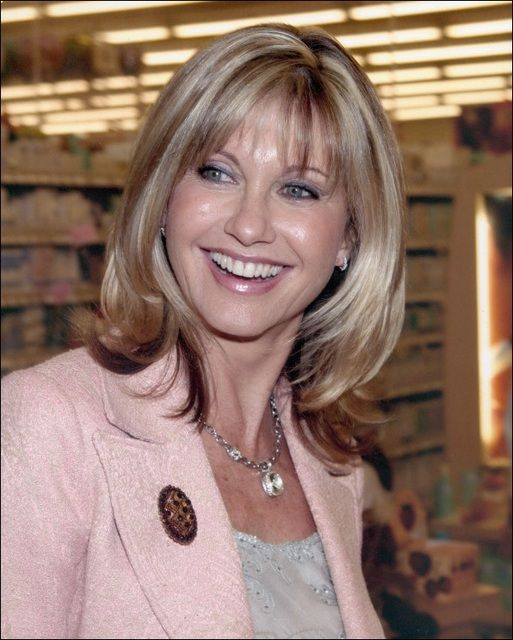 olivia newton john I love this picture of her. She is a real girl crush. I love her hair this way.
