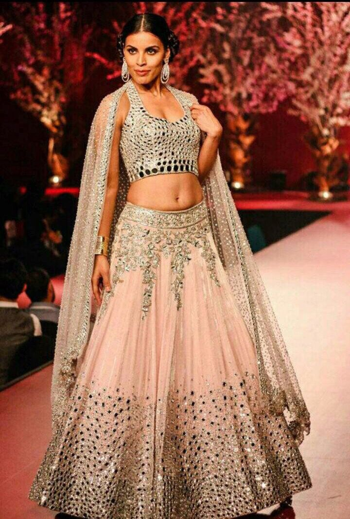 This is a traditional lehenga with mirror work that gives it a modern glamorous touch! Available in stock at #armaansbridal. Customizable according to fit, size and color specifications.