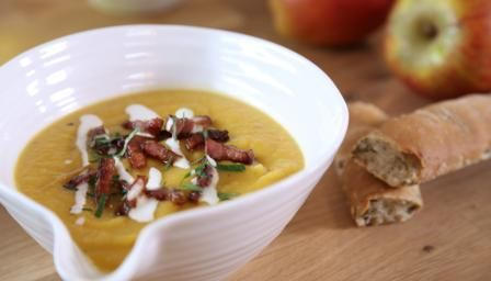 Eating apples give a sweet note to this root vegetable soup, topped with crisp pieces of bacon and crème fraîche.