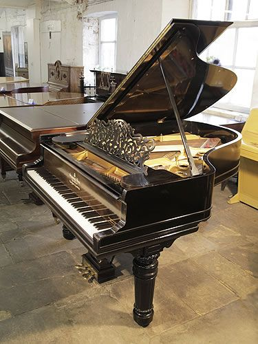 An 1898, Steinway Model A grand piano for sale with a black case, filigree music desk and fluted, barrel legs. Piano has an eighty-eight note keyboard and a three-pedal lyre at Besbrode Pianos £20,000