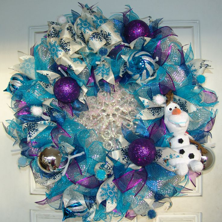 What a fun wreath for Frozen fans! The colors, Olaf, the bow, the glittery snowflake in the center, it's just gorgeous! Easily keep this wreath up all winter long, not just at Christmas time. Or if yo