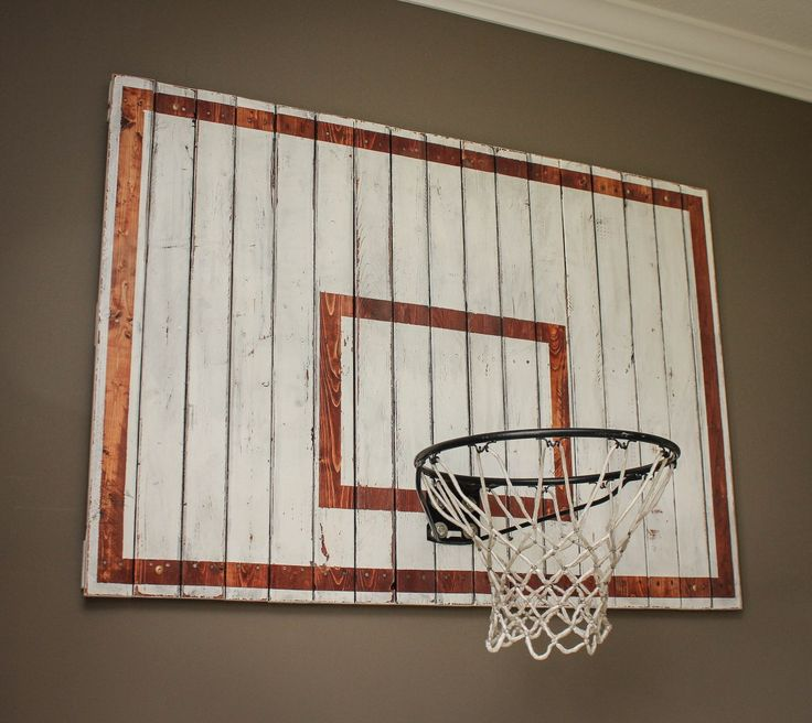 We had a large empty wall in the boys' playroom. I thought briefly about making a big bulletin board to hang their drawings, but thought they'd have much more fun with a basketball hoop…