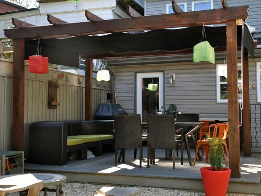 Pergola, patio. Options for awning- take out the trellis but leave the boards and have sunbrella fabric worked through the boards to create shade- but not like this, I'd rather put it over the boards than hanging from under