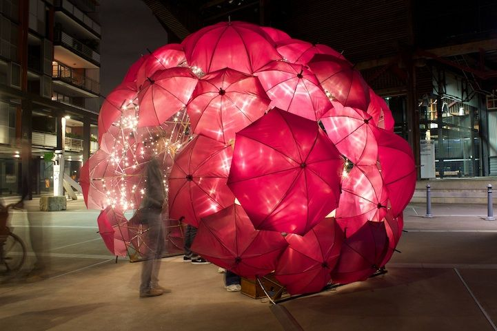 A gorgeous work conceptualized and designed by artist Anna Meister. Umbrellas were strung together and then lit up to create a sparkling igloo! The dome-shaped structure glowed in the night, welcoming those visiting to be, temporarily, whisked away to another world.