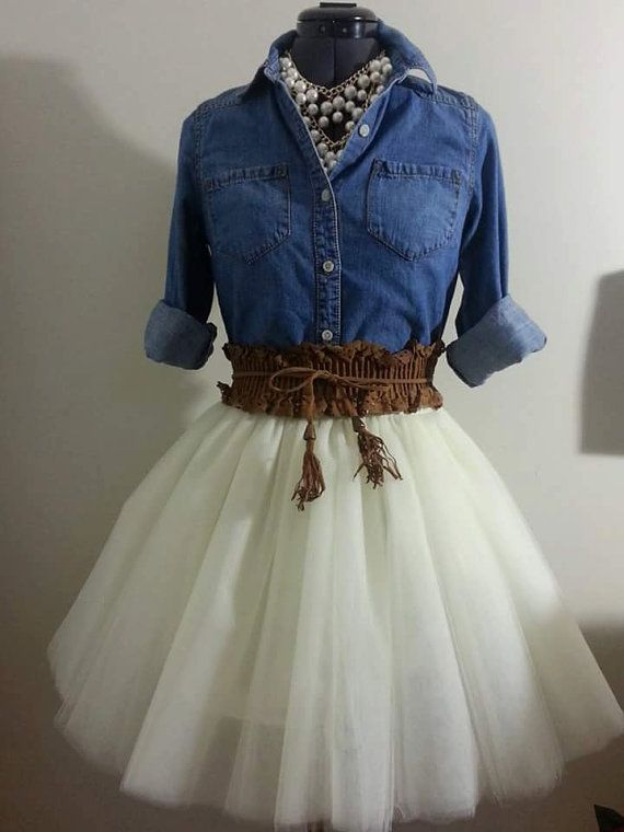 This Skirt is made of 10 layers of ivory tulle Satin waist with hook and I closure Can also make this skirt in any color tulle. This look is