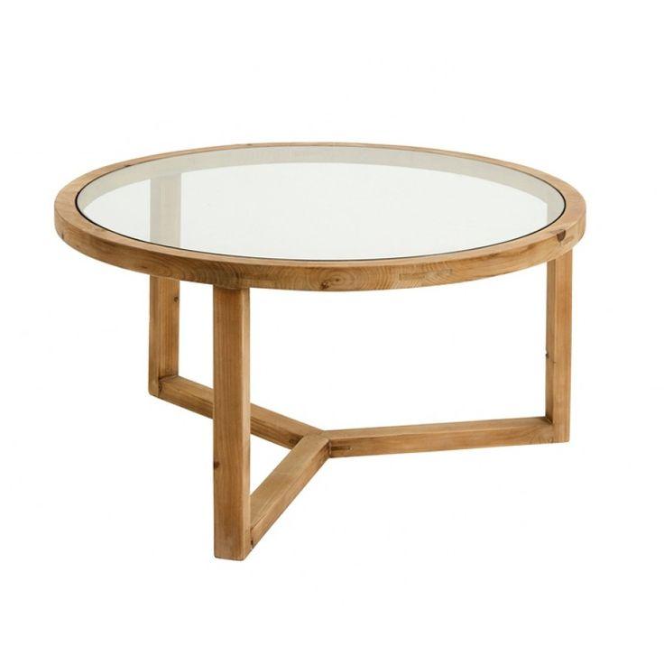 Ett runt soffbord i trä som kommer från det danska varumärket Nordal. Ett vackert och gediget soffbord i trä och glas som ger en härlig naturnära käsla till din inredning. Bordet har en rustik men modern design och p