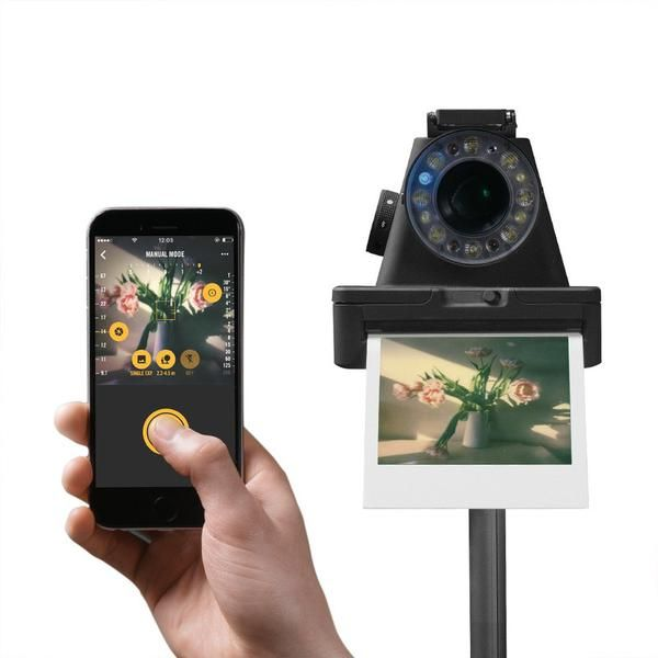 The I-1 is a new generation instant camera, uniquely designed by Impossible to work with a companion App for iOS & Android. It lets you do more with instant photography than was ever before possible. Take full manual control over shutter speed and aperture to make beautiful analog photos in all conditions, or experiment with fun creative tools like light paint and double exposure. The camera's innovatively engineered ring flash, meanwhile, provides a diffused light that's perfect...